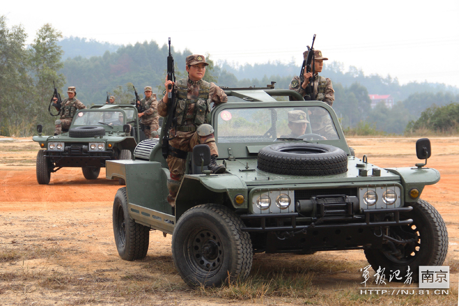 Photo:  Chinese PLA Women's special troops armed with precision-made sniper rifles conduct special warfare training