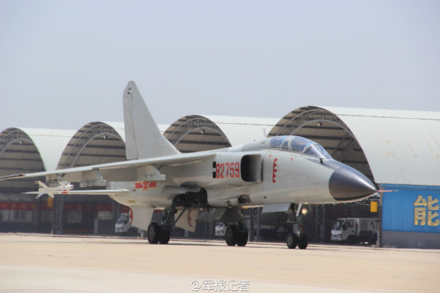 Chinese navy PLAN Xian JH-7 fires air to air missile 6