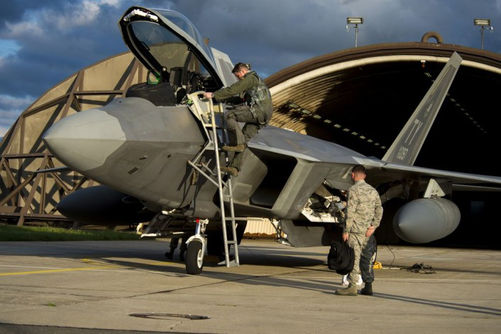 An F-22 Raptor fighter aircraft pilot assigned to the 95th Fighter Squadron at Tyndall Air Force Base, Fla., exits an F-22 at Spangdahlem Air Base, Germany, Aug. 28, 2015. The U.S. Air Force deployed four F-22 Raptors, one C-17 Globemaster III and more than 50 Airmen to Spangdahlem in support of the first F-22 European training deployment. The inaugural F-22 training deployment to Europe is funded by the European Reassurance Initiative, a $1 billion pledge announced by President Obama in March 2014. (U.S. Air Force photo by Airman 1st Class Luke Kitterman/Released)