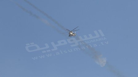 Iraqi Mi-35 helicopter launching airstrikes on the areas surrounding the city of Ramadi