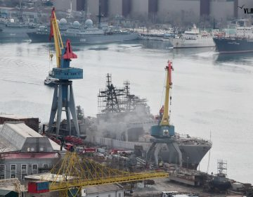 Large anti-submarine ship catches fire in Russian shipyard