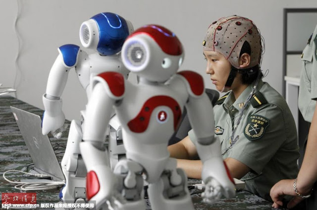 PLA working on controlling robots with brain signals 1