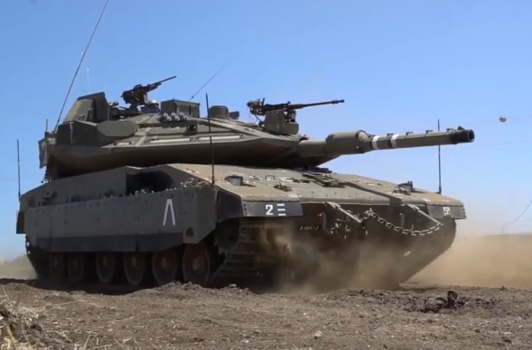 Israeli army deploys tanks, artillery along Syrian border