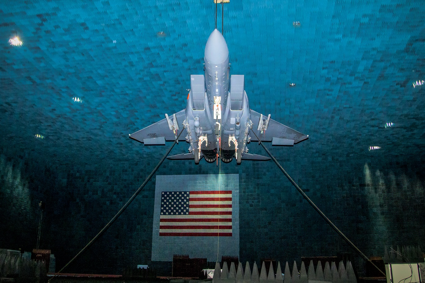 An F-15E Eagle is suspended from the ceiling at the Benefield Anechoic Facility